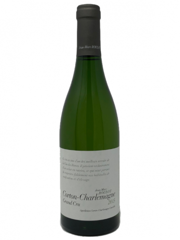 A bottle of 2015 Jean-Marc Roulot Corton-Charlemagne Grand Cru wine.